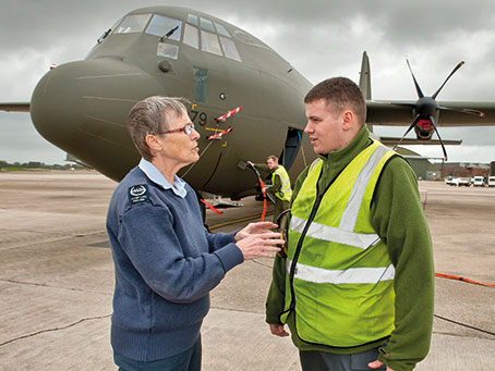 Meg talking with personnel