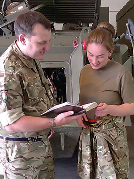 Scripture Reader showing Bible passage to a service member