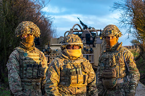 From left to right are a Private (gunner) Cpl (commander) and a Private, Driver of a Jackal vehicle.